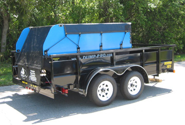 Hi-Sdes and Tarp & Bungee options mounted on a Dump-Pro dump insert mounted on a trailer.