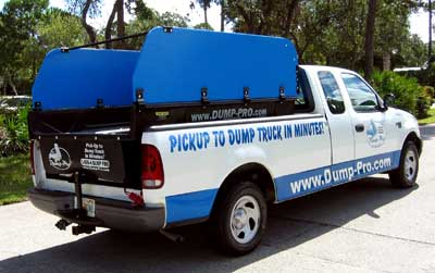 Full-size Dump-Pro dump insert with  Hi-Sides in a pickup truck